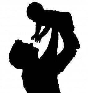 father-holding-baby-in-air-silhouette